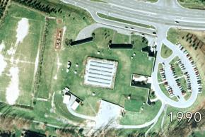 Aerial image of Terra Centre Elementary School taken in 1990. It shows the solar panel array on the roof.