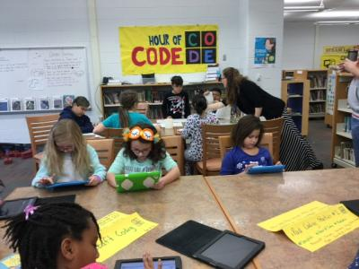 picture of students programming with ipads