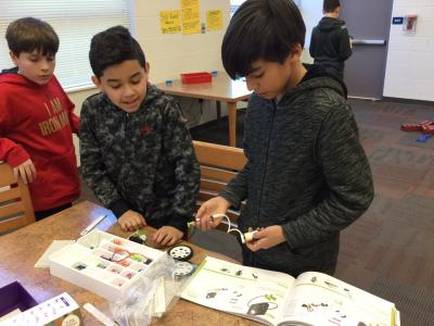 photo of boys using little bits kit